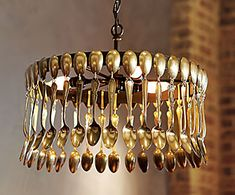 A spoon chandelier. As is for a modern look. Add pearl/chrystal ropes or drops for a more elaborate, fanciful decor. Great basic idea.