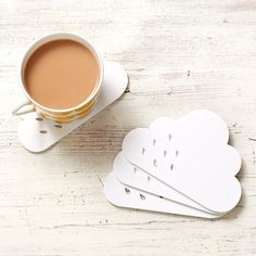 Our rain cloud coaster set is a token celebration of the great British weather! Made from laser cut matt white acrylic with raindrop details, these