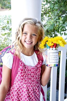 """Back to school teacher gift. The can is filled with markers and daisies and says """"Wishing you a colorful school year."""""""