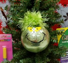 Grinch Christmas ornament with glitter and yarn. Making an ornament for mom each year can become a wonderful tradition. Don't forget to put the year you made the ornament on the bottom.