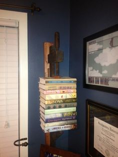 Antique carpentry clamp mounted on a stained board=new book shelf.
