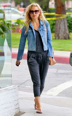 Jumpsuit Enthusiast from Kate Hudson's Street Style  In another jumpsuit, Kate slips on a denim jacket with a nude Maison Martin Margiela bag for this classic look.