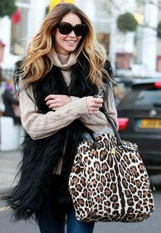 Neutral Sweater, Black Fur Vest, Jeans, Leopard Purse - Elle MacPherson