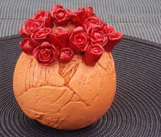 Rose bowl hand made from terracotta clay, displayed at Middleton Arts