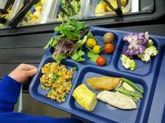Topping up that tray with fresh fruit and veggies in BVSD, Colorado! #schoolfoodsrule