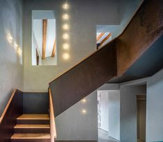 Renovated farm house in Spain featuring rusted steel frames and traditional stone and plaster walls
