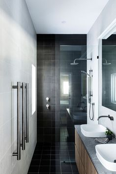 Bathroom Ideas - This modern bathroom has square black tiles that travel from the shower onto the floor, while square grey tiles cover the remaining walls. Black Wall Tiles, Tile Accent Wall, Blue Accent Walls, Grey Tiles, Beautiful Bathrooms, Modern Bathroom, Small Bathroom, Bathroom Ideas, Mini Bad