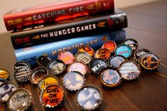 Love these Hunger Games bottle cap pins from Heidi of Digknity via rae gun ramblings--but working with resin looks to be complicated/toxic?
