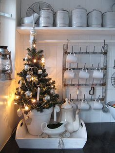 Love the cup rack and how cute to tuck a little tree in there.  Heck, love it all!