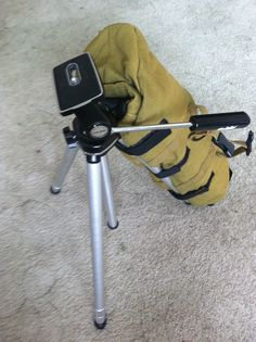 Velco added to underside of bag so tripod can be used with bag attached.