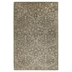 Welcome guests in the foyer or anchor your living room seating group with this eye-catching rug, artfully crafted of a plush wool blend for cozy comfort and ...