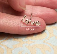 """love"" cartilage earring"