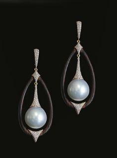 inbar  diamonds, pearls and wood.   Organic.
