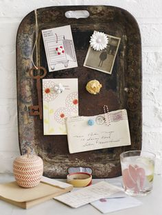 old jewelry magnets - love the rusty memo board