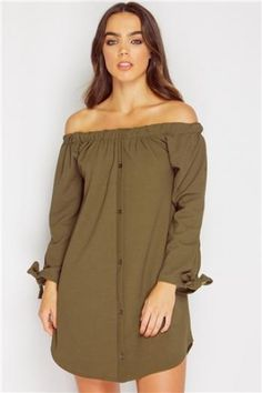 e8a1322b965bc7 Let the dress do the talking and add a sweet flare to your fresh new vibe  with our transitional Kaarina Khaki Tie Detail Bardot Dress! Nail the bardot