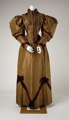 Dress, bronze silk with burgundy trim.  Date: 1893–94 Culture: American  Metropolitan Museum of Art  Accession Number: C.I.58.2a, b