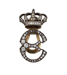 A ROYAL MONOGRAM CYPHER GENTLEMAN'S LAPEL BADGE BY MASENZ, ROME, CIRCA 1900. The 'E' set with old-cut diamonds, with an openwork crown above, mounted in silver and gold. The initial is for Elena, Queen of Italy.