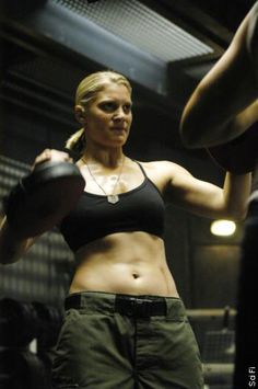 Katee Sackhoff as Captain Kara Thrace, aka Starbuck. She'll kick your teeth in without hesitation.
