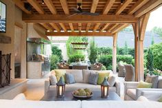 Covered patio with outdoor kitchen and outdoor living room. #patio  Austin Bean Design Studio.
