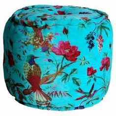 """Blue velvet pouf with a floral bird motif and single-button tufting. Product: PoufConstruction Material: Velvet cover and cotton fillColor: BlueDimensions: 16"""" H x 16"""" DiameterCleaning and Care: Spot clean"""