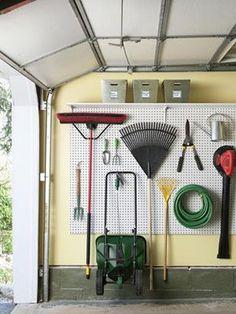 Garage organization - pegboard and shelf above