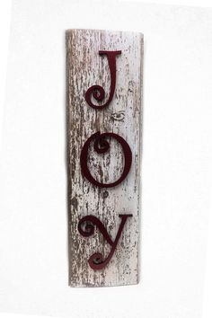 """Large Joy Sign. Hung on a wall, simply placed under the tree or as a Christmas gift, this sign is an original and elegant decoration. It's made of old recycled barn wood and pine. Measures 12"""" wide by"""
