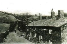 Buildings Row, Fold Road, Ringley stood just uphill from the Manchester, Bolton & Bury Canal, and backed onto the site of the old Ringley Colliery. Ringley Wood can be seen in the background, as five soberly-dressed people head down the road towards the camera [photo probably taken from Folds Road bridge over the MB&B canal]. Bury, Manchester, The Row, Buildings, Bridge, Old Things, Childhood, House Styles, Wood