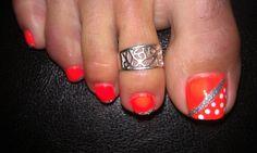 Pedicure with custom nail art.