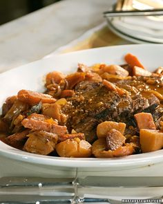 Pot Roast - Martha Stewart Recipes. Trying this one for dinner tonight. I subbed low sodium V8 for the can of tomato soup because that's what I had on hand.