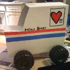 My son's postal-monster-truck valentine box last year.... think we're going to try a robot this year.   Made from a shoe box and wheels from a cheap dollar store truck. They're are monster truck flames painted on the other side :)