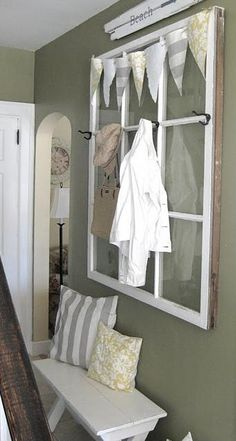 old window with added hooks for hallway decor/function