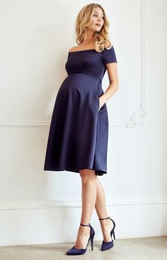 The ultimate occasion dress for maternity glamour – Aria is simply breathtaking in our rich new navy satinesque fabric. Channelling starlet beauty with a Bardot neckline that sits just off the shoulder and a sleek skirt that falls perfectly at the knee.