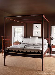 Who needs a fussy canopy? Certainly not the spare, but warm, master bedroom.