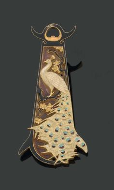 René Lalique. Oblong Pendant. 18 kts gold decorated with cloisonne enamel: white/  peacock blue/ turquoise/ purple.  A branch of fruit tree and flowers carved with black enamel. (photo Pierre Bergé & Associés)