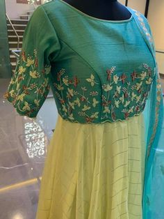 Stunning sea green and powder blue combination floor length dress with floret lata design hand embroidery thread work. Ready to shipPrice : 7500 INR.To order whatsapp 04 February 2019 Dress Neck Designs, Bridal Blouse Designs, Long Gown Dress, Long Frock, Frock For Women, Indian Gowns Dresses, Kurta Designs Women, Anarkali Dress, Indian Designer Wear