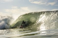 """""""Carl Holmes makes his northern migration every winter to visit his family,"""" says Chris Burkard. """"But mostly he makes the trek for barrels like this."""" Photo: Burkard"""