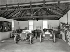"Christchurch, New Zealand, circa 1908. ""Wolseley and Cadillac motor cars in garage."" Glass plate by the Steffano Webb Photographic Studio."