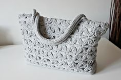 A star stitch variation. Ravelry: Crochet Star Bag pattern by Tatiana Zuccalà