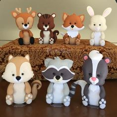 Cute Woodland Animals to display on food table then the mom-to-be can put in nursery.Image may contain: 1 person Fondant Cake Toppers, Fondant Figures, Cupcake Toppers, Fondant Cupcakes, Polymer Clay Creations, Polymer Clay Crafts, Woodland Cake, Fondant Animals, Fondant Decorations