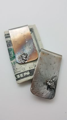 "Out of this world gift for Dad! Meteorite Gifts for Men. One of a kind Stainless steel money clip with Meteorite. Each one is unique and handmade. Coolest Gift!    *** EACH money Clip is handmade and varies. You are purchasing the money clip that is in the 2nd photo of this listing.****  Fast shipping!      This Money Clip has heat patina and texture to make it a truly unique gift for the graduate. A father's day gift that dad will love!  2"" long  1"" wide  If you would like initials hand…"