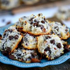 EASY Almond Joy Cookies take just four ingredients and don't even require a mixer! No beating, no chilling, just a quick stir and into the oven they go!