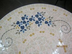 Mosaic floral table by Lisa B