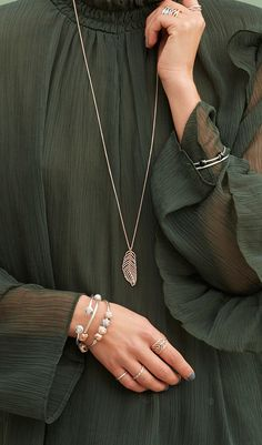 Style tip: forest green and PANDORA Rose go great together! Give it a try at one of December's many Christmas parties.