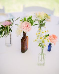 Glacier Park Weddings | Petite centerpieces in vintage bottles by Habitat Floral Studio | Photo by Cluney Photo #vintagewedding #pink