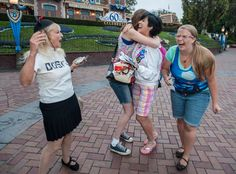Dusty Frank, left, Arielle Boardman, Leeann Carruth and Lacey Brocious, are overcome with emotion after they were chosen as the first guests for Disneyland's 60th birthday celebration Friday morning. http://www.ocregister.com/articles/disney-672399-disneyland-park.html