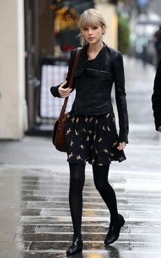 Taylor Swift Street StyleLeather and a dress: Layering this leather jacket over her black ensemble adds a little edge to the whimsical dress. via StyleList
