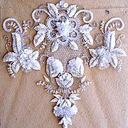 Zardozi is an ancient Persian art (Zar in Persian means gold and Dozi is embroidery) which has been passed down for many generations, dating back before the Mughal empire.
