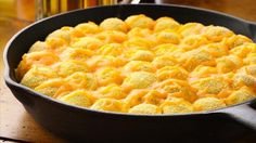 Cheesy Jalapeño Popper Monkey Bread - A spicy jalapeño popper monkey bread filled with cream cheese and topped with cheese.