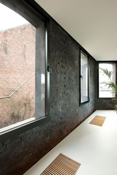 Interior of House G-S by Graux & Baeyens Architects. Nice contrast between the rough, blck brick wall and the smooth floor. I also like the warmth of the wood in contrast to the floor.