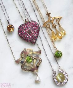 Perfect for layering! Colorful antique and contemporary pendants set with peridot, citrine, and sapphire. All from Doyle & Doyle.
